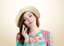 Young girl in hat with a cellphone in his hand Royalty Free Stock Photos