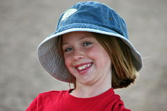 Young Girl in a Hat Stock Images