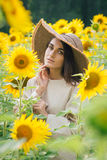 Young girl in a hat on a field of sunflowers Royalty Free Stock Photo