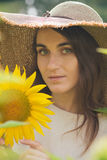 Young girl in a hat on a field of sunflowers Royalty Free Stock Images