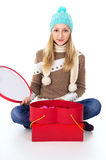 Young girl in a hat with gifts isolated Royalty Free Stock Photo