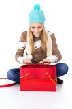 Young girl in a hat with gifts isolated surprised Royalty Free Stock Photos