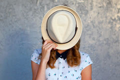 Young girl with hat. Hides her face.Depression. Stock Images