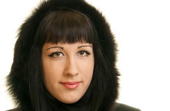 Young girl with hat  made of fur. Portrait of a young girl with hat  made of fur Stock Photo