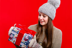 Young girl in hat and mittens with gift box Royalty Free Stock Image