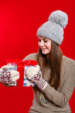 Young girl in hat and mittens with gift box Stock Image