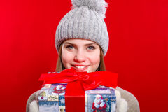 Young girl in hat and mittens with gift box Stock Photography