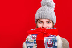 Young girl in hat and mittens with gift box Royalty Free Stock Photo