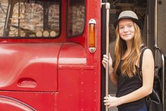 Young  girl in hat near the truck. Stock Photo