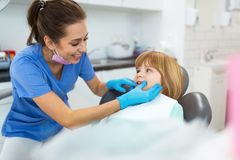 Little girl in the dentists office stock image