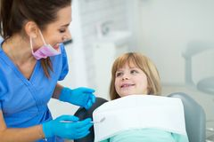 Little girl in the dentists office royalty free stock photography