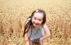 Young girl have fun in wheat field Stock Images