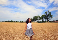 Young girl have fun in the wheat field Royalty Free Stock Photography