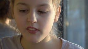 Young girl having breakfast stock footage