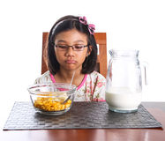Young Girl Having Breakfast III Royalty Free Stock Image