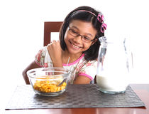 Young Girl Having Breakfast IV Royalty Free Stock Photos