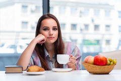 The young girl having breakfast on the morning Stock Photo