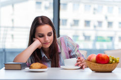 The young girl having breakfast on the morning royalty free stock image