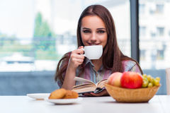 The young girl having breakfast on the morning Stock Photos