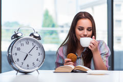 The young girl having breakfast on the morning Stock Images
