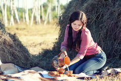 Young girl having breakfast at wheat field Royalty Free Stock Images