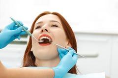 Young girl having a dental checkup. Young beautiful girl having a dental checkup Royalty Free Stock Photos