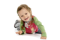 Young girl having fun. On white floor Royalty Free Stock Image