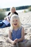Young girl having fun at beach. Stock Image