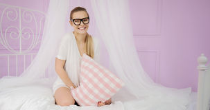 Young girl having fun in bed. royalty free stock photography