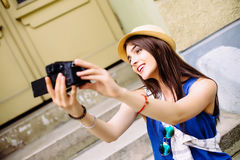 Young girl having fun in the city with camera travel photo of photographer Making pictures Royalty Free Stock Photo