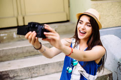 Young girl having fun in the city with camera travel photo of photographer Making pictures Stock Photos