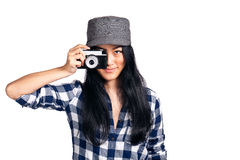Young girl having a fun with her camera. A young asian girl having fun with a camera over one eye while getting ready to take a photo Royalty Free Stock Photo