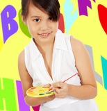 Young Girl Having Fun Painting Stock Photography