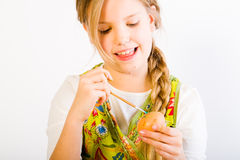 Young girl having fun painting eggs for easter Stock Image