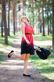 Girl having fun in the park. Portrait of a young girl having fun with a bag in the park Stock Photos