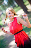 Teenage girl having fun in park. Young girl playing with hairs Stock Photo
