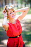 Teen girl having fun in park. Young girl playing with hairs Stock Photo