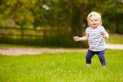 Young Girl Having Fun Playing Game Outdoors Stock Image