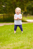 Young Girl Having Fun Playing Game Outdoors Stock Photo