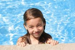 Young girl having fun in the pool stock photos