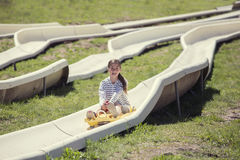 Young girl having fun riding a outdoor coaster ride Royalty Free Stock Images