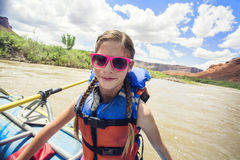 Young girl having fun on a river rafting trip down the Colorado River Royalty Free Stock Photo