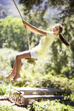 Young Girl Having Fun On Rope Swing Stock Photography