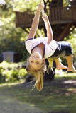 Young Girl Having Fun On Rope Swing Royalty Free Stock Photos