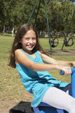 Young Girl Having Fun On Seesaw Stock Photo