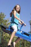 Young Girl Having Fun On Seesaw Royalty Free Stock Photos