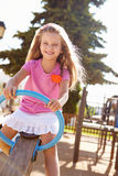 Young Girl Having Fun On Seesaw In Playground Royalty Free Stock Photo