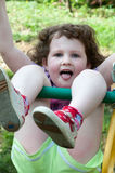Young girl having fun on a swing. A young girl having fun on a swing Royalty Free Stock Image