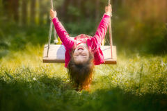 Young Girl Having Fun On Swing Royalty Free Stock Photography