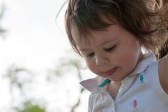 Young girl having fun on a swing set Stock Photo